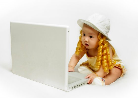 Travel Postcard - Baby Girl with Laptop