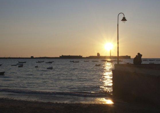 Travel Postcard - Puesta de sol en la Caleta